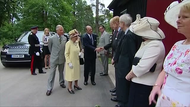 exterior showing queen elizabeth shaking hands with officials and representatives prince philip and prince charles present on july 02 2014 in... - verwaltungsbehörde dumfries and galloway stock-videos und b-roll-filmmaterial