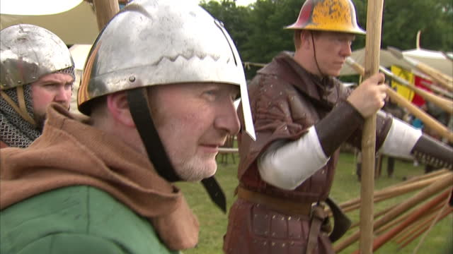 exterior shows battle re enactment participants at festival people dressed in historically accurate battle clothing hand out spears for celebratory... - スコットランド スターリング点の映像素材/bロール