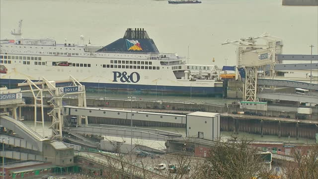 Exterior shows cars and lorries coming of large ferry docked in Dover port on March 20 2014 in Dover England