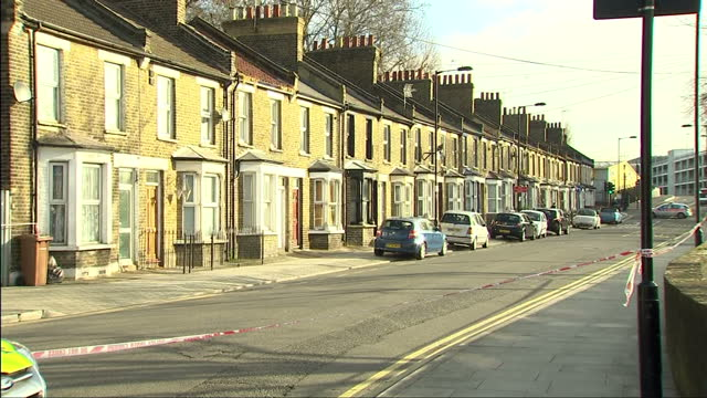 exterior shows cordoned off residential road with terraced housing police on scene with police vehicles on march 20 2014 in london england - hackney stock videos & royalty-free footage