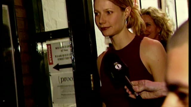 exterior shows gwyneth paltrow leaving donmar warehouse poses for photos before making way to car through press melee on may 15 2002 in london england - gwyneth paltrow stock videos and b-roll footage