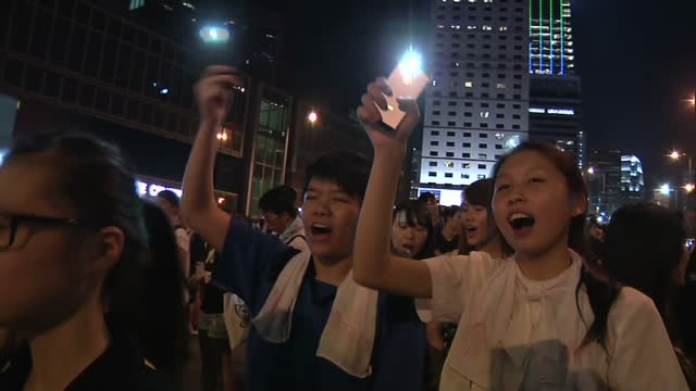clean exterior shows night time demonstration in progress demonstrators chant in unison holding illuminated mobile phones on september 30 2014 in... - 2014 stock videos and b-roll footage