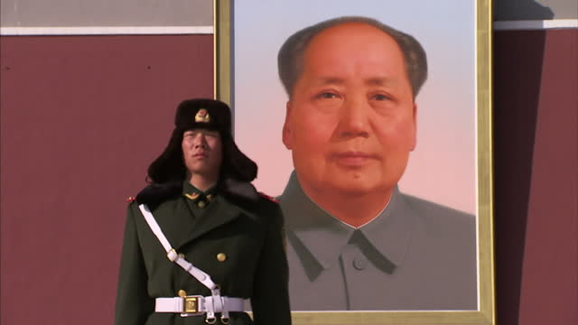 exterior shows police officer standing still with poster of mao zedong in background - sports poster stock videos & royalty-free footage