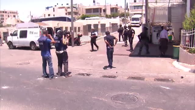 Exterior shows reporter Sherine Tadros delivers piece to camera as tear gas canister exploded yards away media and security present on July 02 2014...