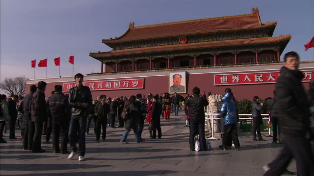 exterior shows tourists and visitors in tiananmen square gate of heavenly peace - tiananmen gate of heavenly peace stock videos & royalty-free footage