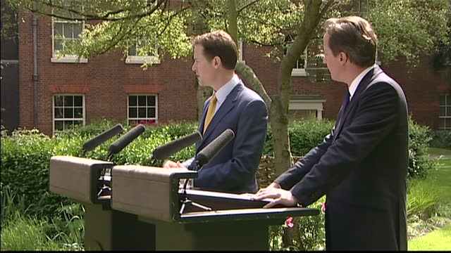 vidéos et rushes de exterior side view david cameron and nick clegg speech and eager to make sure that the big society is matched by big citizens where power is taken... - 2010