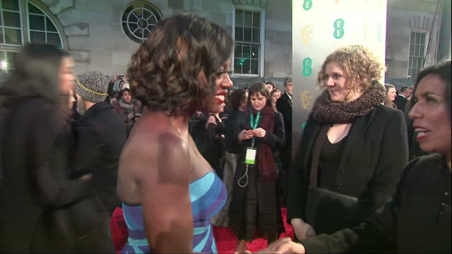 Exterior side view night shot of Viola Davis actress in Fences film walks and speaks to press on red carpet smiling etc at the BAFTA Awards at the...