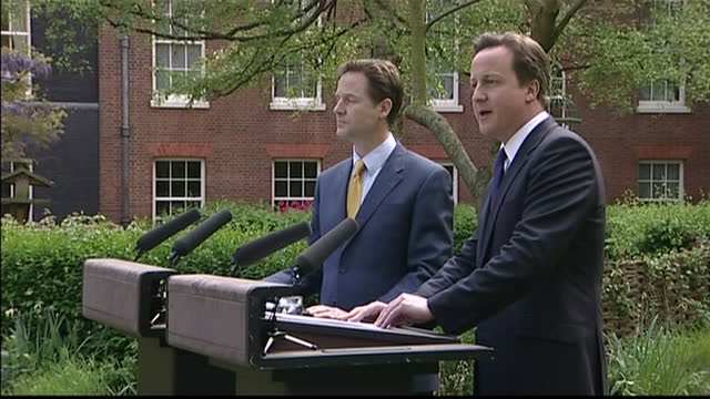 stockvideo's en b-roll-footage met exterior side view of david cameron speech in the rose garden on the steps of downing street yesterday evening i said that nick and i wanted to put... - 2010