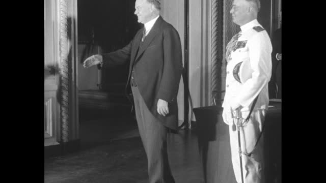exterior side view of white house / president herbert hoover enters east room of the white house and stops former president calvin coolidge... - hands behind head stock videos & royalty-free footage