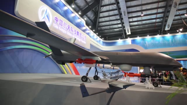 stockvideo's en b-roll-footage met exterior signage for china aerospace exhibition hall at the china international aviation aerospace exhibition in zhuhai guangdong province china on... - aan elkaar bevestigd