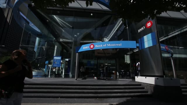 exterior signage of a bmo bank of montreal location as pedestrians walk by in vancouver canada on august 25 2017 photographer ben nelms shots wide... - montreal stock videos and b-roll footage