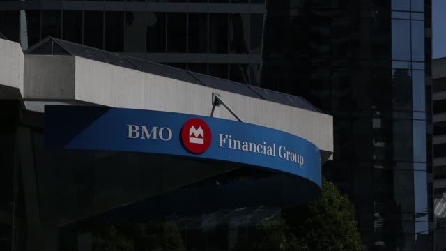 exterior signage of a bmo bank of montreal location in vancouver canada on august 25 2017 photographer ben nelms shots cu of bmo sign on display wide... - montreal stock videos and b-roll footage