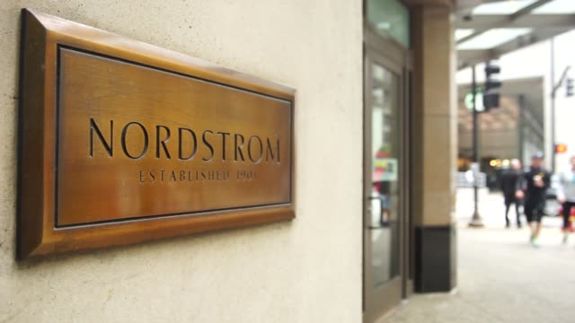 stockvideo's en b-roll-footage met exterior signage of a nordstrom store in chicago il on august 4 2017 photographer christopher dilts shots cu of nordstrom signage on plate on wall... - nordstrom