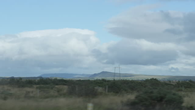 stockvideo's en b-roll-footage met exterior slow motion driving shots past icelandic scenery, mountains and landscapes on 9 september 2020 in reykjavik, iceland - clean