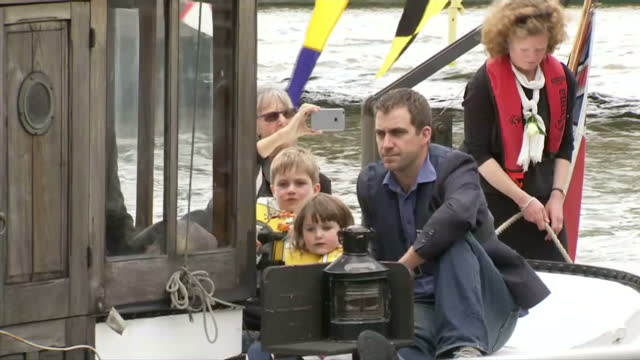 exterior sots of a flotilla filled with roses anchored in the thames river brendan cox on a boat with his children marking the memory of jo cox mp... - jo cox politician stock videos and b-roll footage