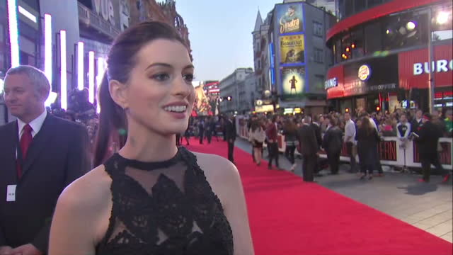 Exterior soundbite with Anne Hathaway speaking about how her character in The Intern does not follow the stereotype of being a 'tough' female boss>>...
