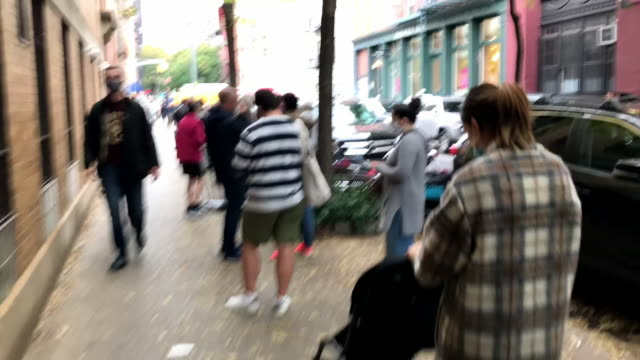 exterior speeded up tracking views of long queues of people queing for early voting in the us presidential election on 24 october 2020 in new york... - waiting in line stock videos & royalty-free footage