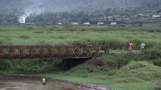 exterior steady shot of a field with a bridge in view.  - キガリ点の映像素材/bロール