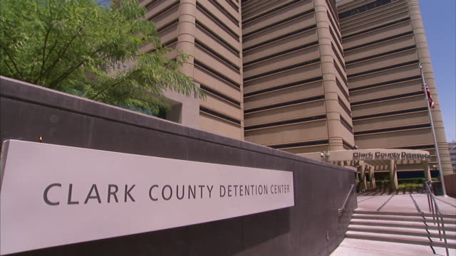 exterior steps lead to the entrance of the clark county detention center in las vegas, nevada. - clark county nevada stock videos & royalty-free footage