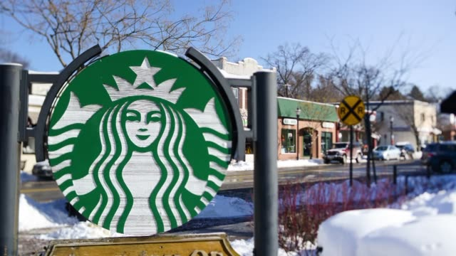 exterior time lapses of starbucks in new york city on wednesday january 22nd, a zoom in timelapse of a glass front starbucks building, a close up... - coffee drink stock videos & royalty-free footage