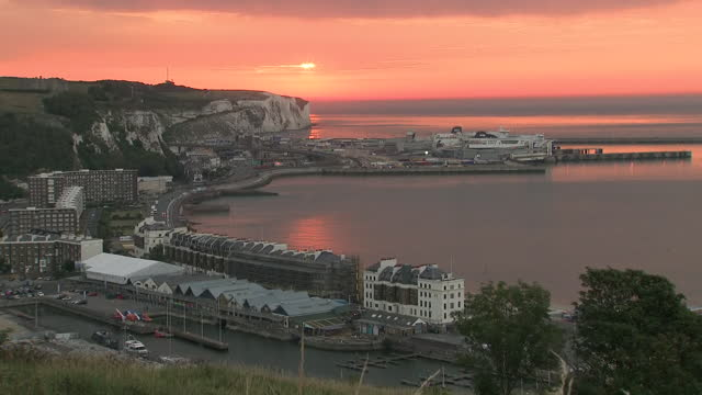 exterior timelapse of a red sunrise over dover port on 8 august 2020 in dover, united kingdom - pink colour stock videos & royalty-free footage