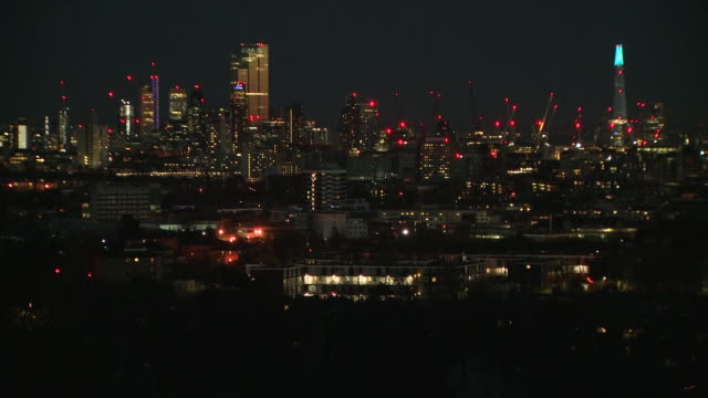 exterior timelapse shots of the london skyline featuring the city of london including the shard and swiss re buildings at night time on 4 april 2020... - blurred motion stock videos & royalty-free footage