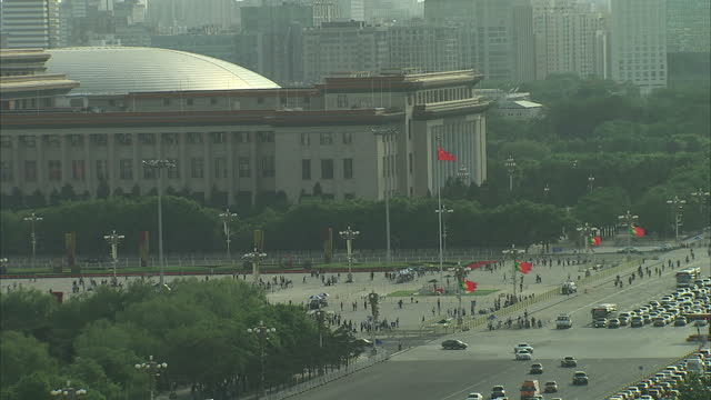 exterior top shot very busy road full of traffic people milling in tiananmen square and government buildings with insignia on june 04 2014 in beijing... - insignia stock videos and b-roll footage