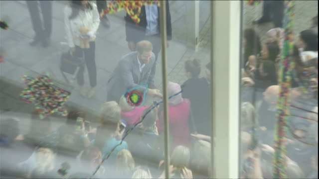 exterior top shot views seen through a glass roof of the duke of sussex greeting crowds outside oxford children's hospital on 14 may 2019 in oxford... - 病棟点の映像素材/bロール