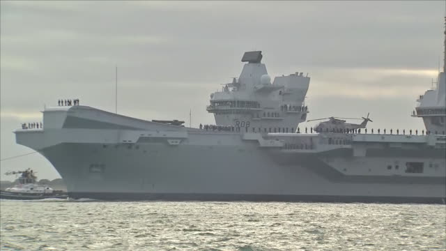 exterior view of aircarft carrier hms queen elizabeth departing portsmouth navel base for flight trials off the coast of north america on 18th august... - navel stock videos & royalty-free footage
