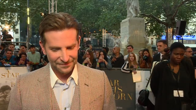 exterior view of an interview with director and actor bradley cooper on the red carpet at the london premiere of her new film a star is born on... - lady gaga stock videos & royalty-free footage