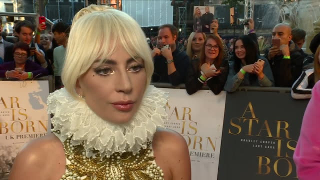 exterior view of an interview with lady gaga on the red carpet at the london premiere of her new film a star is born on september 27 2018 in london... - lady gaga stock videos & royalty-free footage