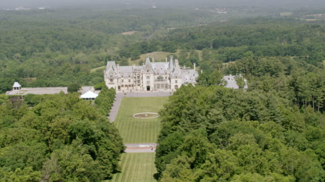 WS AERIAL POV Exterior view of Biltmore Estate with forest area / Asheville, North Carolina, United States