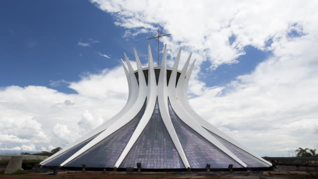 TL, MS Exterior view of Brasilia Cathedral / Catedral Metropolitana with moving clouds / Brasilia, Brazil