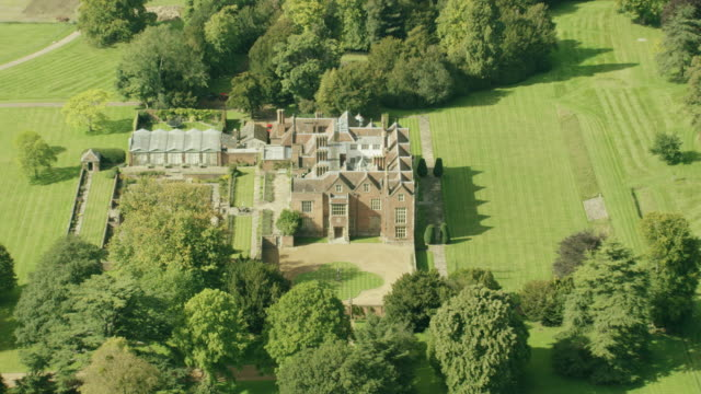 WS AERIAL POV ZI Exterior view of Chequers House with field area / London, England, United Kingdom