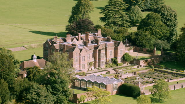 WS AERIAL POV Exterior view of Chequers House with field area / London, England, United Kingdom