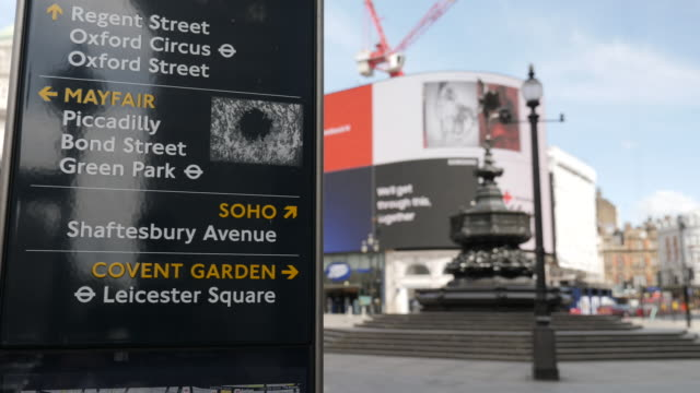 exterior view of direction sign post at piccadilly circus during coronavirus outbreak on 5th may 2020 in london united kingdom - famous place stock videos & royalty-free footage