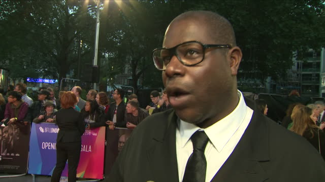 exterior view of director steve mcqueen interviewed on the red carpet at the premiere of his film widows at the london film festival in leicester... - film director stock videos and b-roll footage