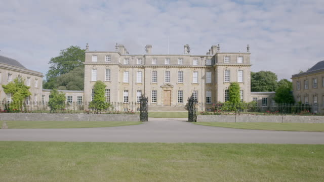 WS TD Exterior view of Ditchley House with domestic garden / Charlbury, Oxfordshire, England, United Kingdom