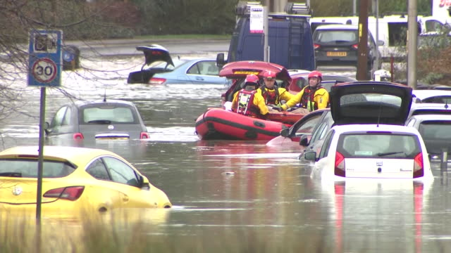 exterior view of emergency rescue personnel with life rafts rescuing people from flooded houses on the outskirts of cardiff in nantgarw on 16... - people stock videos & royalty-free footage