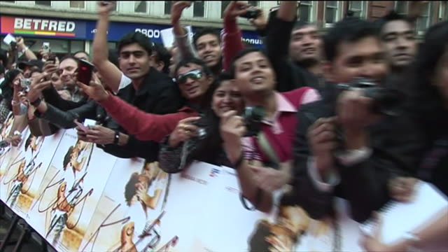 exterior view of hrithik roshan at london film premiere of kites being interviewed signing autographs and posing for photographs with barbara mori on... - bollywood stock videos and b-roll footage