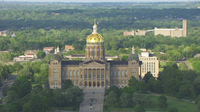 WS AERIAL POV Exterior View of Iowa State Capitol in city / Des Moines, Iowa, United States