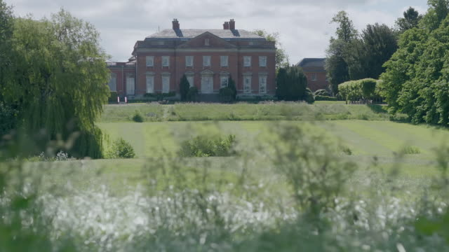 ws tu exterior view of kelmarsh hall with garden / northamptonshire, england, united kingdom - stately home stock videos and b-roll footage