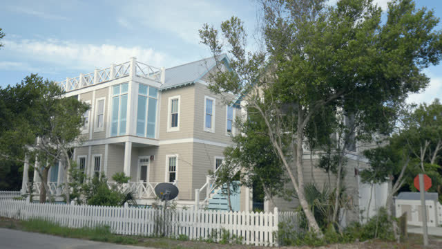 exterior. view of luxury two-story bald head island beach house with rooftop balcony on a sunny summer day. - bald head island stock videos & royalty-free footage