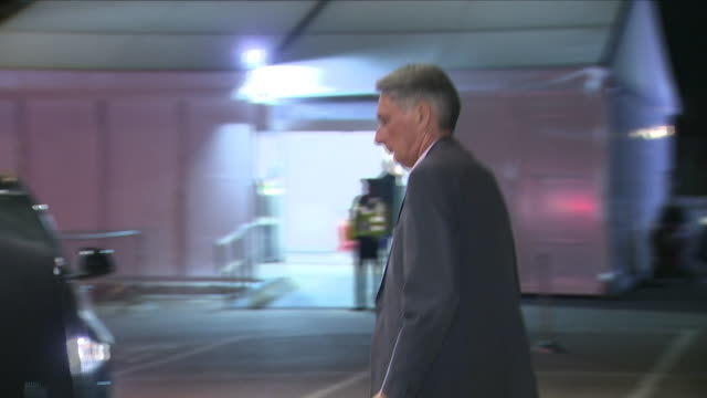exterior view of phillip hammond as he leave his hotel at the conservative party conference on september 29 2018 in birmingham england - フィリップ ハモンド点の映像素材/bロール