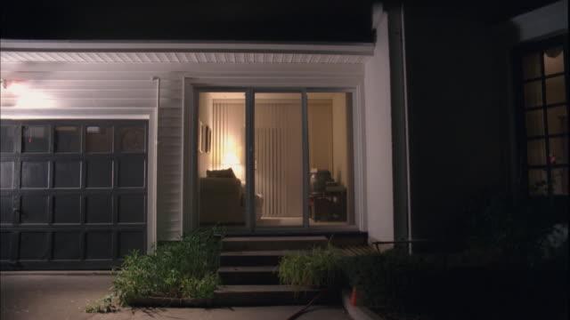ms, exterior view of  porch windows of suburban home at night, reno, nevada, usa - nevada stock videos & royalty-free footage