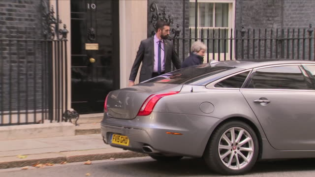 exterior view of prime minister theresa may leaving 10 downing street and getting into her official car before driving off to attend the 2018 budget... - prime minister stock videos & royalty-free footage