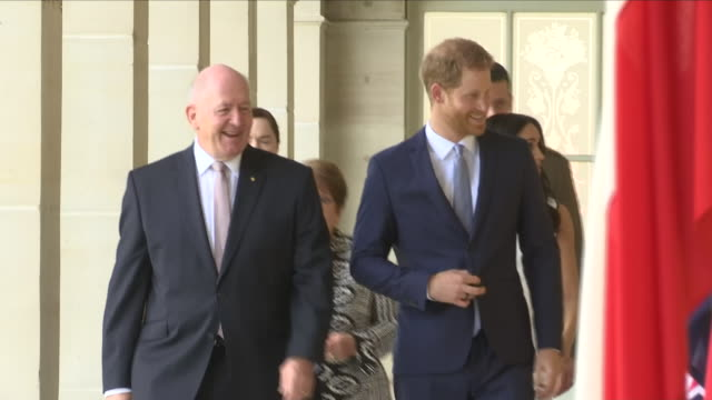 Exterior view of Prince Harry and Meghan The Duke and Duchess of Sussex walking along with Governor General Sir Peter Cosgrove and Lady Cosgrove at...