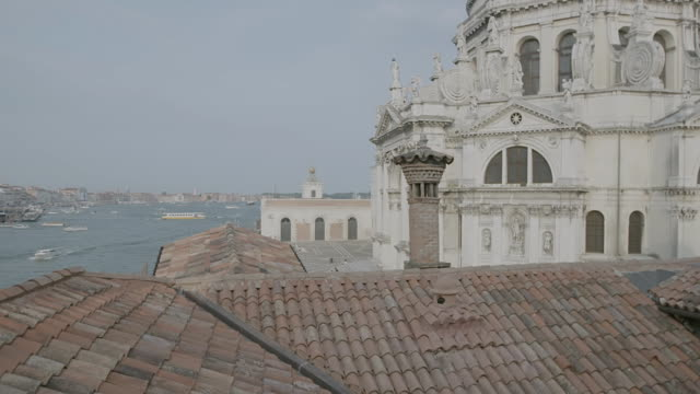 WS TD Exterior view of Santa Maria della Salute church, boats moving in canal / Venice, Italy