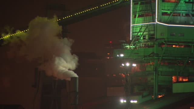 exterior view of steel mill at night - chimney stock videos and b-roll footage