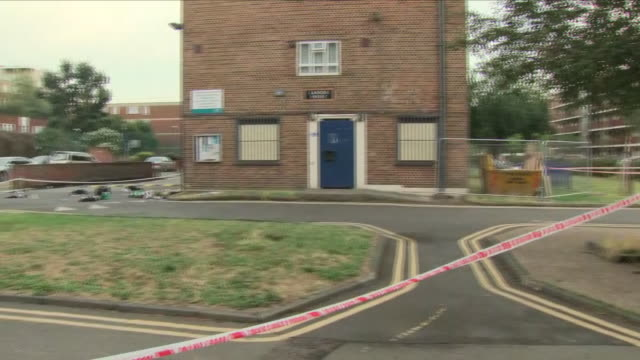 exterior view of the crime scene at camberwell after four teenagers were stabbed on the elmington estate camberwell road including police crime scene... - messerstecherei stock-videos und b-roll-filmmaterial